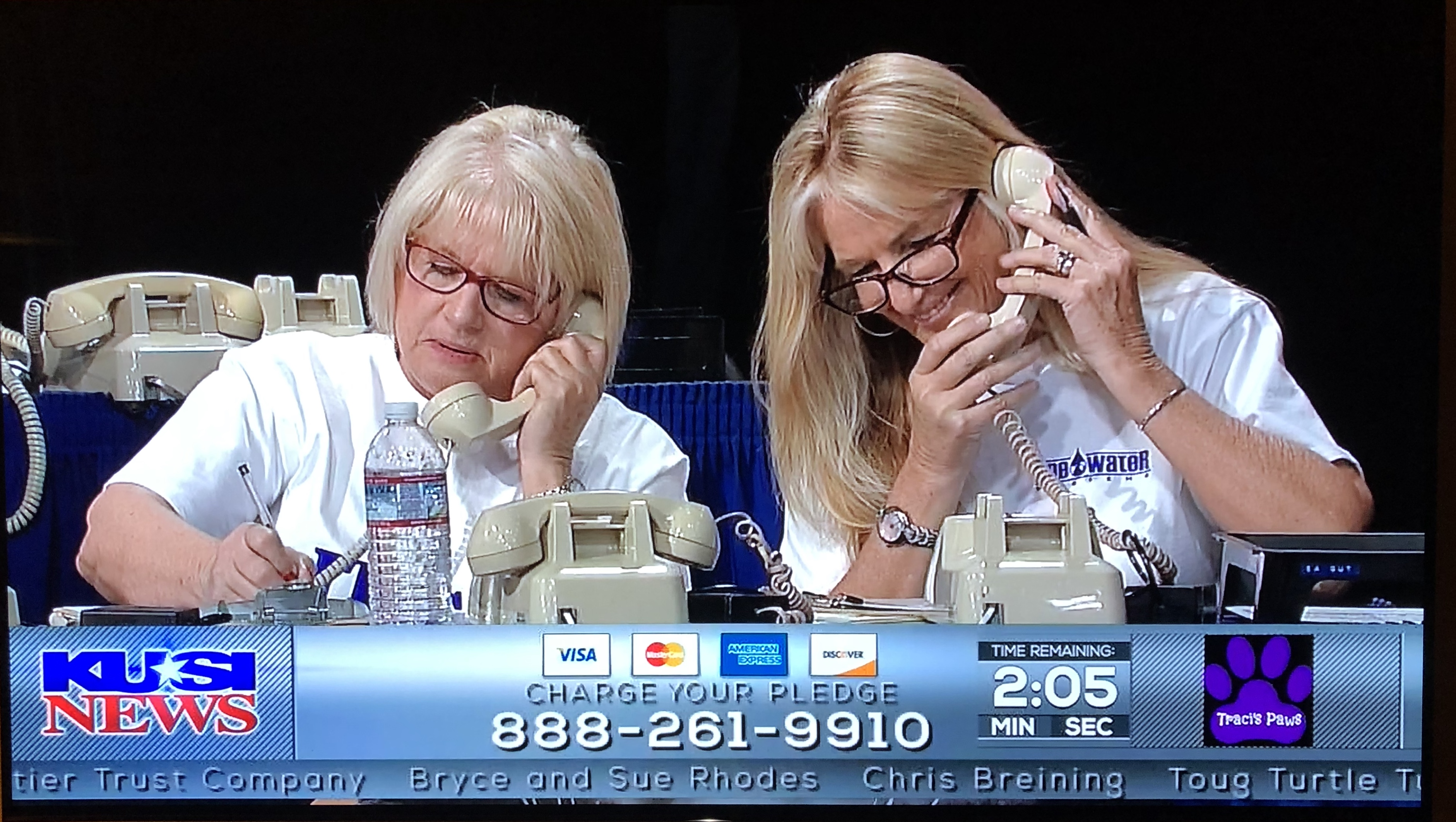 A couple of One Water Systems ladies answering phones and taking donations